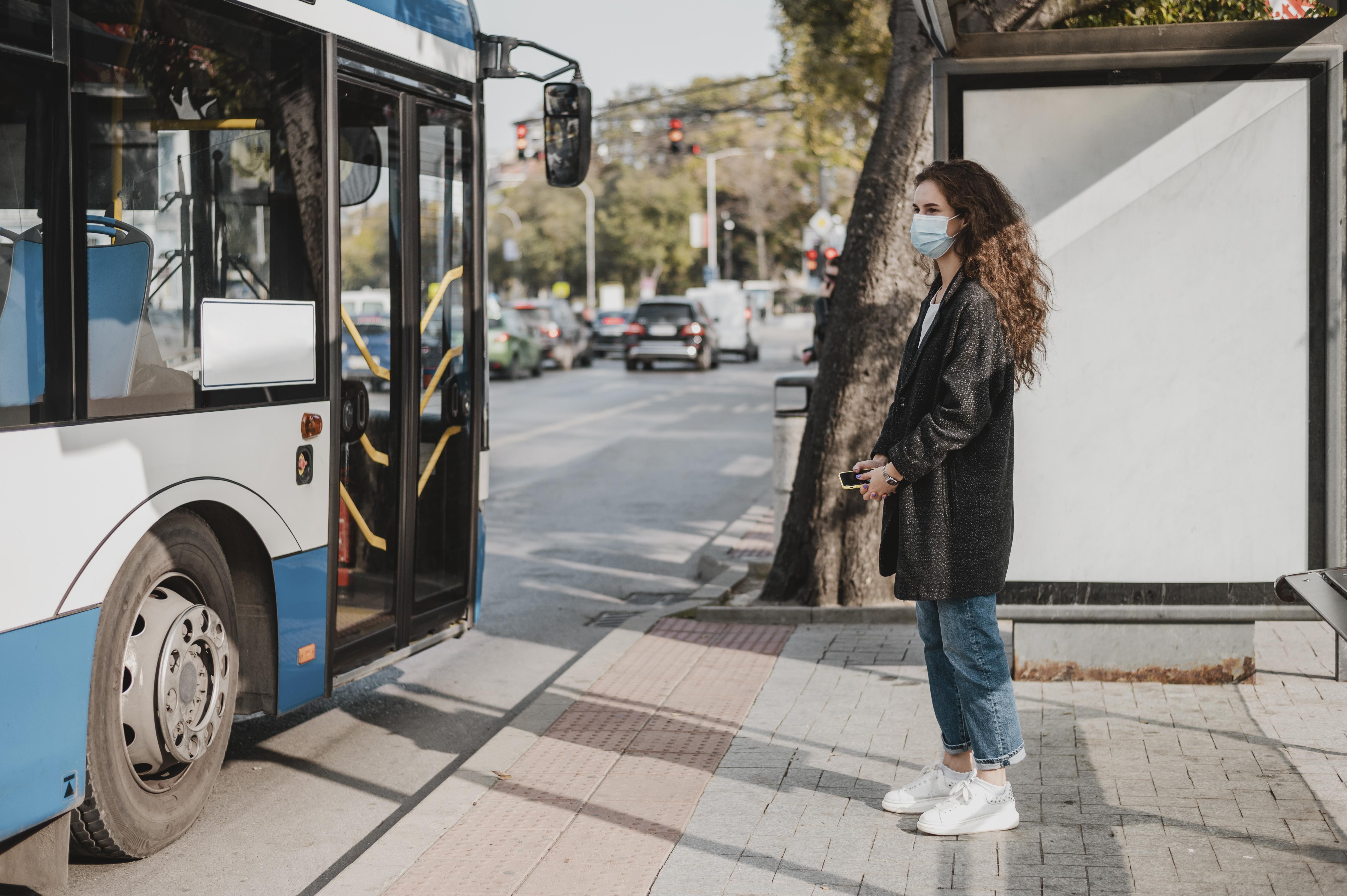 side-view-woman-waiting-for-the-bus