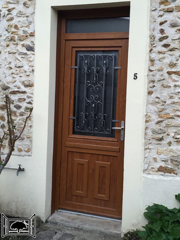 Porte d'entrée à châssis ouvrant PVC chêne doré