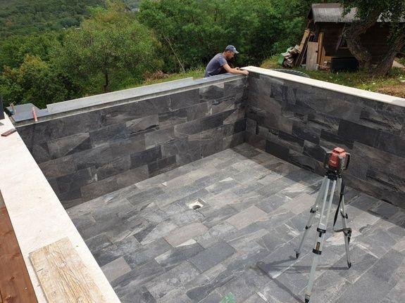 Construction piscine à débordement